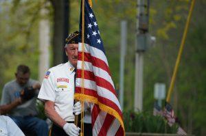 Veteran Holding the American Flag - VeteranCarDonations.org